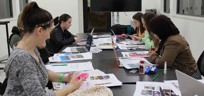 Yearbook staff works on a project.